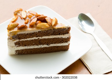 A Slice of Coffee Almond Cake on white plate