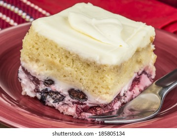 A slice of creamy berry cake