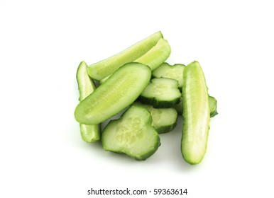 Slice of cutted cucumber over white for design