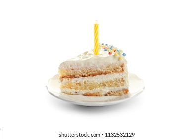 Slice of delicious birthday cake with candle on white background