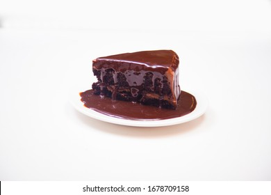 A slice of delicious chocolate cake. Piece of Cake on a white Plate.