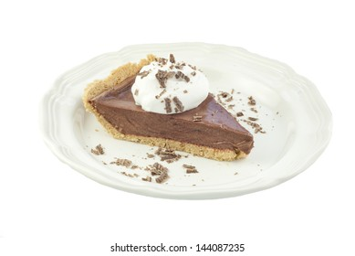 A slice of delicious chocolate cream pie topped with whipped cream and chocolate shavings, isolate on white background