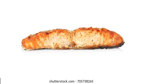 Slice of delicious fried salmon on white background
