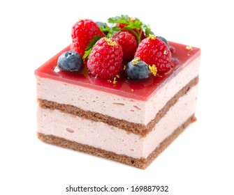 Slice of delicious layered and glazed raspberry mousse cake isolated on white background