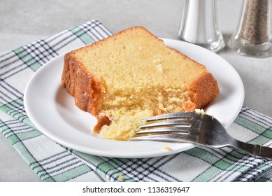 Slice of delicious pound cake with a missing bite