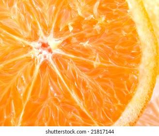 Slice of a fresh juicy orange close up.