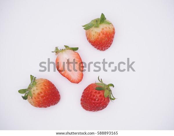 a slice of Fresh Korean Strawberries on a white background