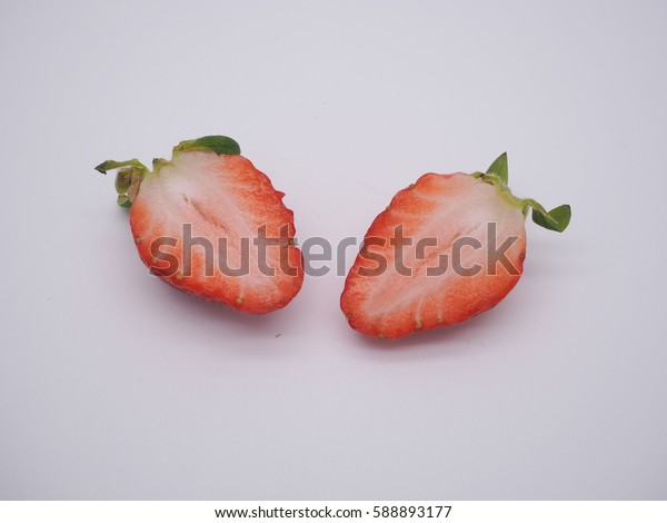 a slice of Fresh Korean Strawberries on a white background