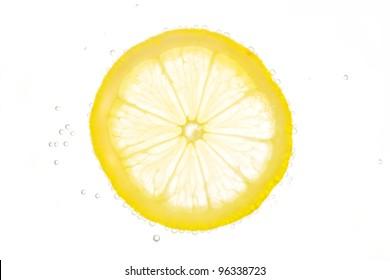 Slice of fresh lemon in soda water