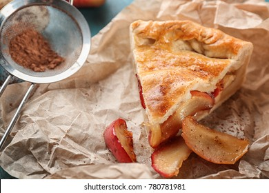 Slice of freshly baked apple pie on parchment, closeup
