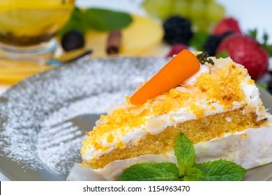 Slice of freshly baked gourmet carrot cake - Shutterstock ID 1154963470