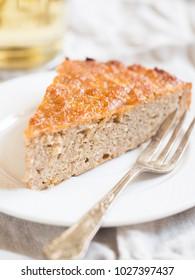 Slice of gluten free (almond flour) apple cake.