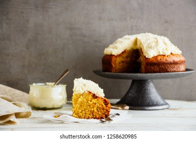 A slice of homemade coconut cake with mascarpone cream