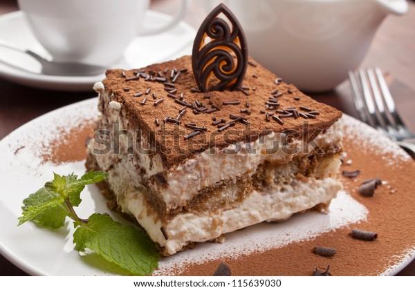Slice of homemade italian tiramisu dessert served on a plate