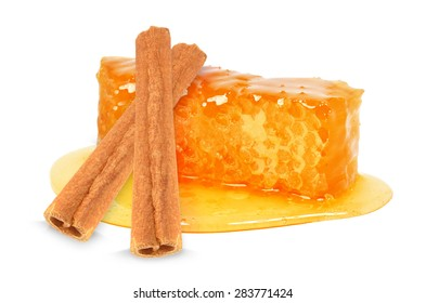 slice of honey and cinnamon isolated on white background