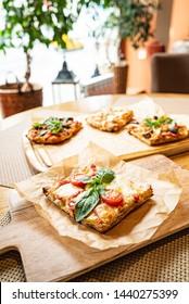 slice of italian pizza in the pizzeria