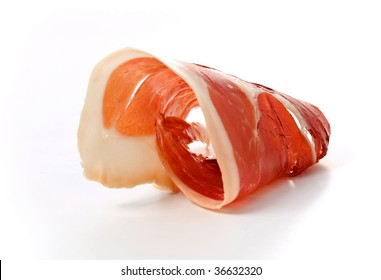 A slice of jamon, rolled on white background.