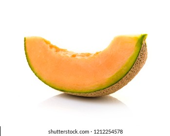 slice of japanese melons, orange melon or cantaloupe melon with seeds isolated on white background.