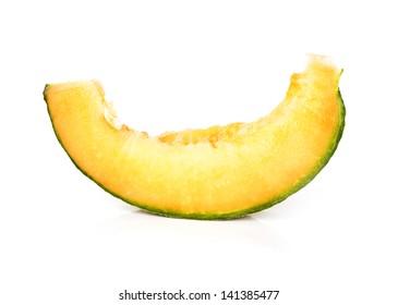 Slice of juicy cantaloupe melon isolated over white background