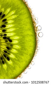Slice of a kiwi in the mineral water