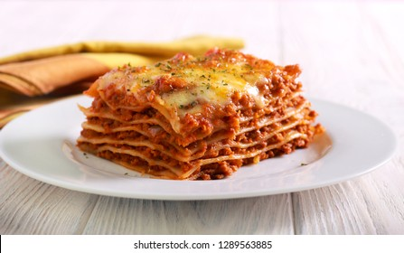 Slice of lasagna  on plate selective focus