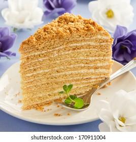 Slice of layered honey cake.