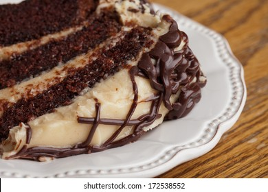 Slice of layered whipped peanut butter and chocolate cake