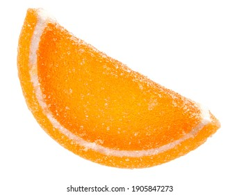 A slice of marmalade orange is isolated on a white background. Marmalade candy.