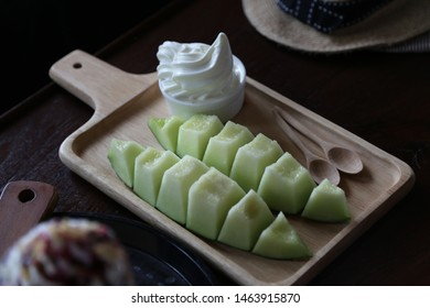slice melon with ice cream on wooden dish