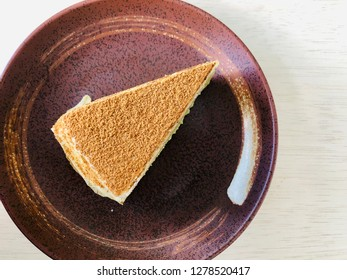 Slice of mille crepe cake topped with kinako powder