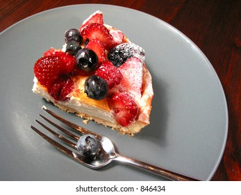 Slice of mixed berry tart on a plate