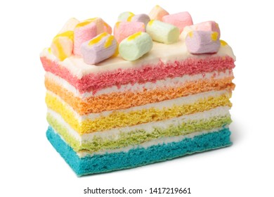 Slice of multicolored cake with marshmallow on white background