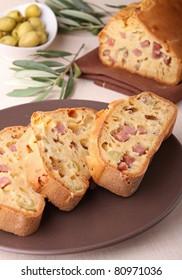 slice of olive and ham cake