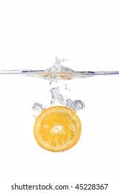 slice of orange dropped in water