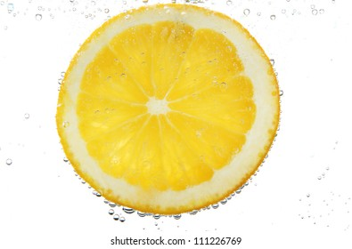 slice of orange in the water with bubbles, isolated on white