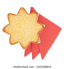 Slice of pandoro, Italian sweet yeast bread, traditional Christmas treat. With red serviettes isolated on white. Overhead flat lay view.