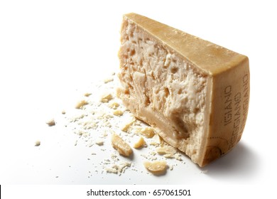 Slice of parmesan cheese over white background