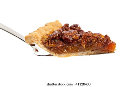 A slice of pecan pie on a white background