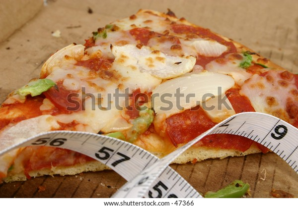 Slice of pizza in box with measuring tape laying in box too.