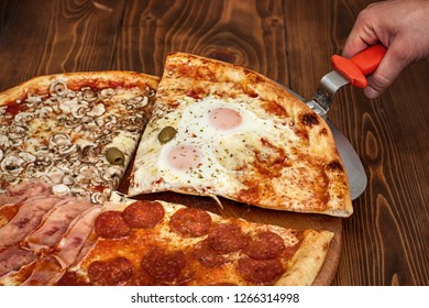 Slice of pizza quattro stagioni on scapula on wooden table. Tasty fast food italian traditional