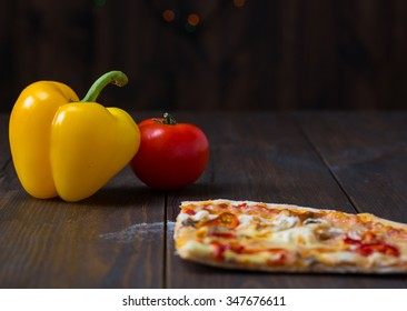 slice of pizza with vegetables on a wooden background