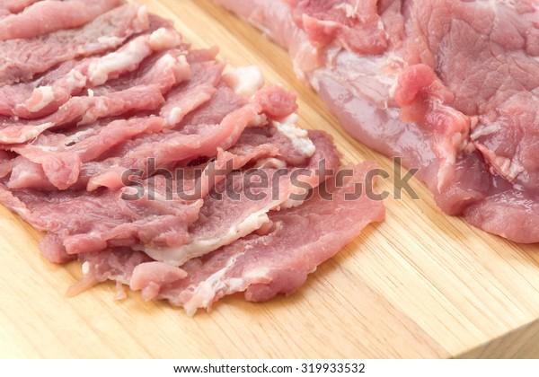 slice pork on wood board