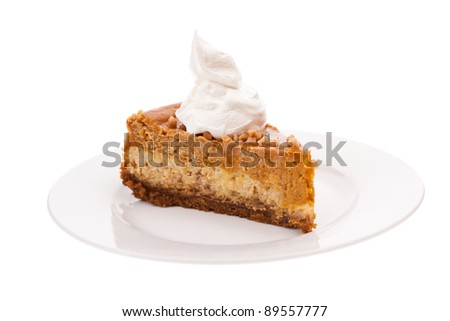 Slice of pumpkin cheesecake isolated on white