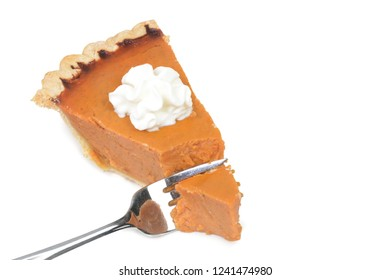 slice of pumpkin pie and fork isolated white background thanksgiving dessert