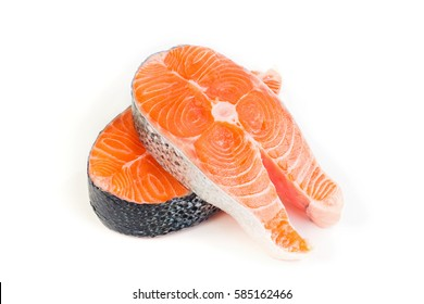 The slice of raw red fish  on a white plastic background. Closeup, details