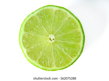 Slice of ripe Lime isolated on white background