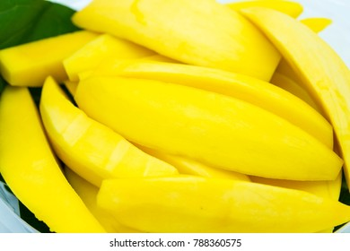 Slice ripe mango on plate.