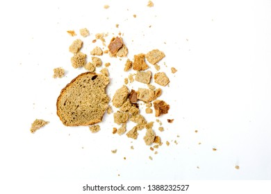 Slice of rye bread and breadcrumbs isolated on white. bread crumbs