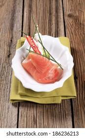 Slice of smoked salmon, mozzarella cheese and kiwi