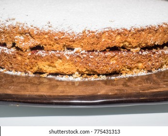 a slice of the sponge cake with afternoon tea.